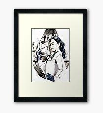 Qira Framed Print