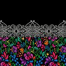 Traditional flower ethnic seamless floral pattern on black background by eszadesign