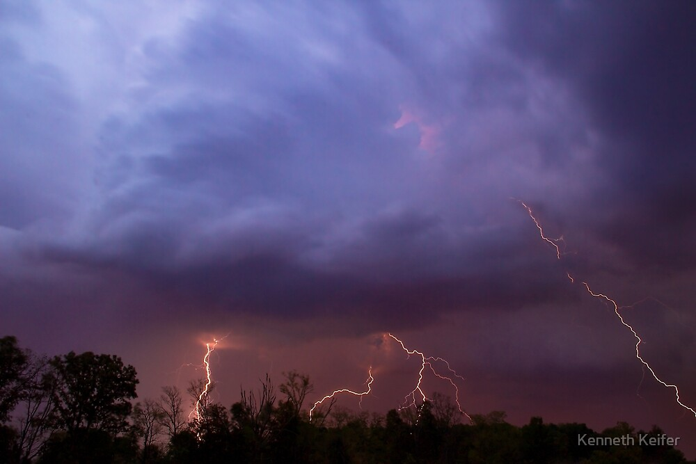 Multiple Lightning Strikes form Colorful Thunderstorm Clouds by Kenneth Keifer