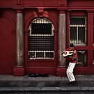 red busker by Tony Day