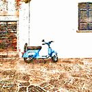 Arona: motorbike between a door and a window by Giuseppe Cocco