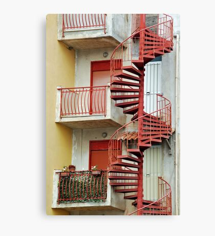 Winding staircase in red Canvas Print
