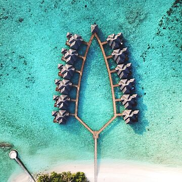A drone shot of a group of water villas/bungalows in Maldives by The-Drone-Man