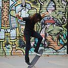 Skater + graffiti by Xavier Russo