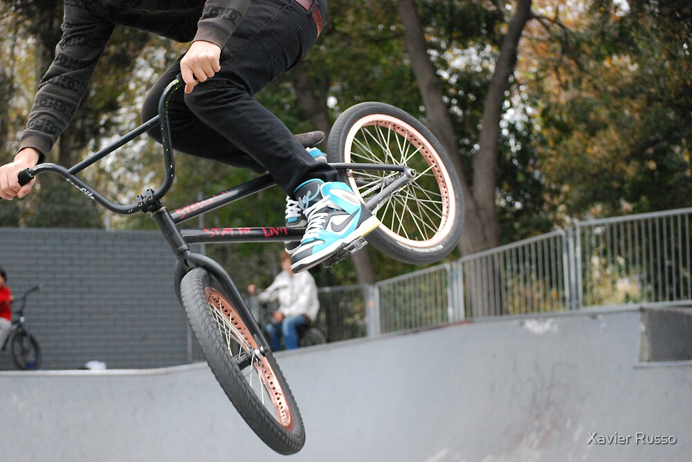 Bike in mid-air by Xavier Russo