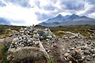 A collection of cairns left by walkers at Sligachan, Isle of Skye by Richard Flint