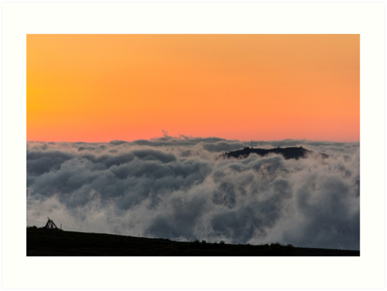 Orange sunset with mountain silhouette in clouds, Gulahuayco, Ecuador by Kendall Anderson
