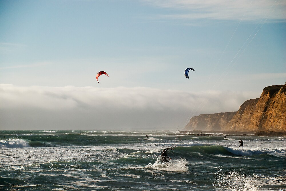 Kite boarding in high winds under the bluffs by MarkEmmerson