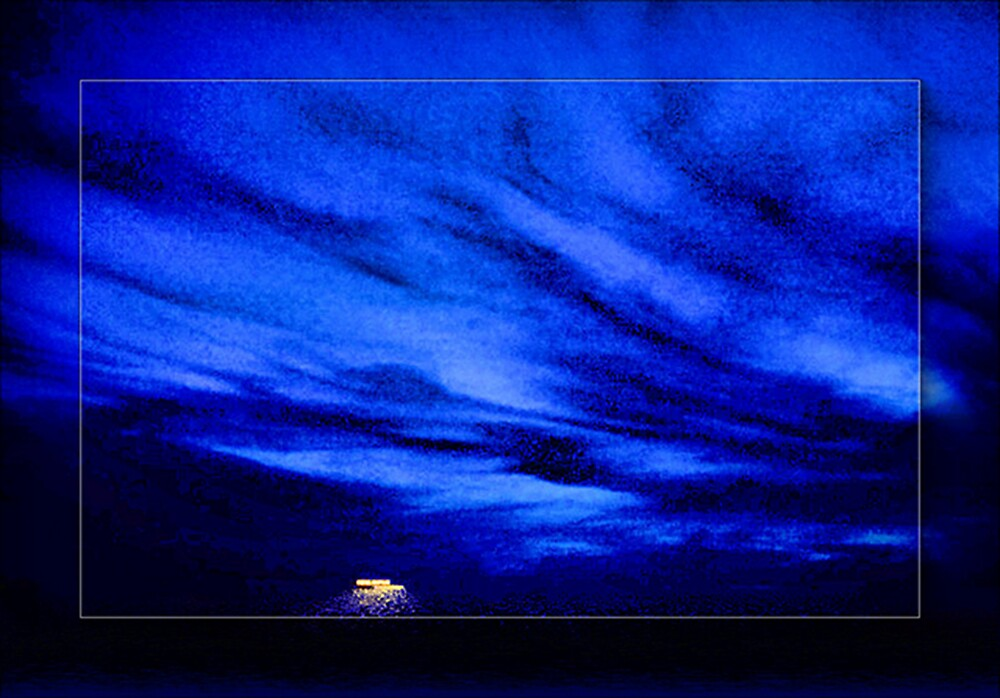 A Solitary Light On The Sea by Rick Wollschleger
