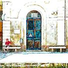 Man in red sitting on the train station bench by Giuseppe Cocco