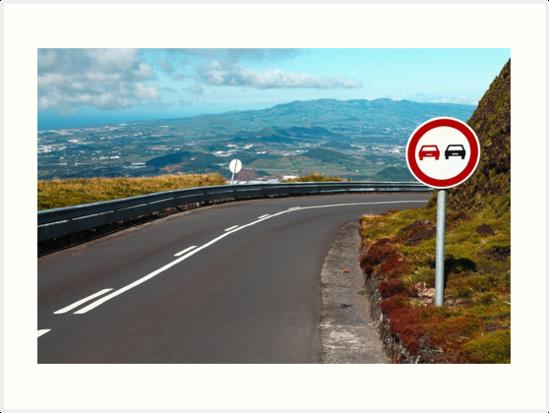 Empty road with turn by Gaspar Avila