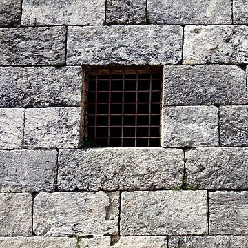 stone rock wall prison jail window  by natbern