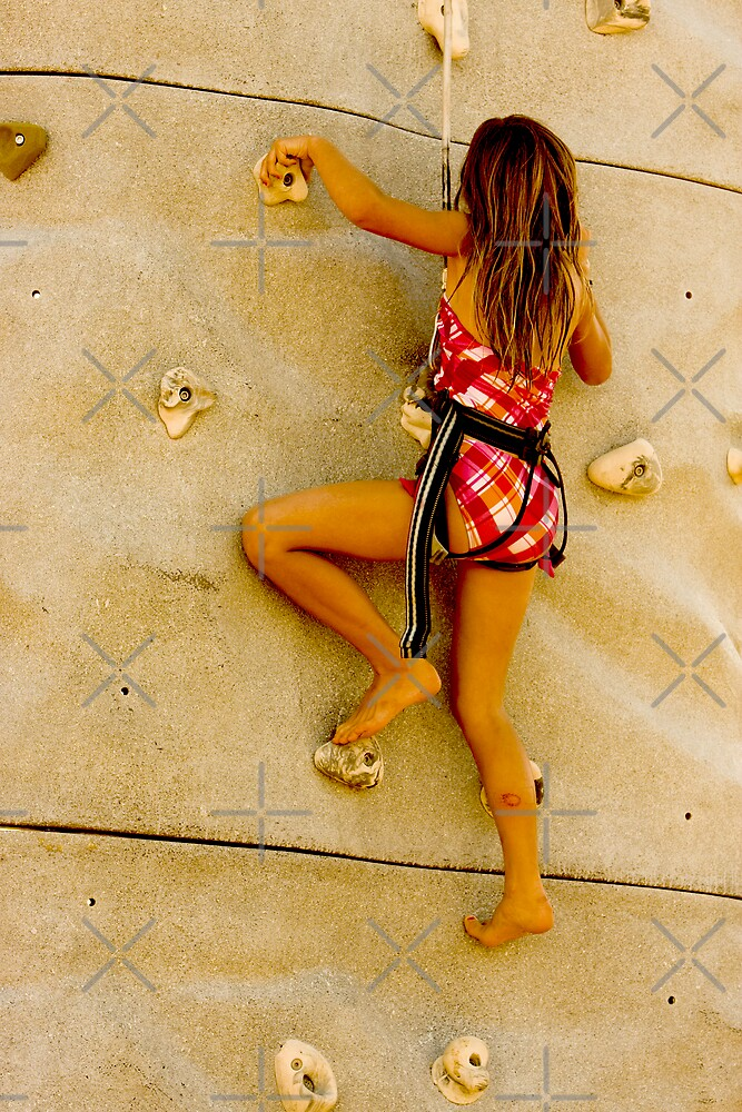 Climbing Wall - Young Girl Climbs to the Top\