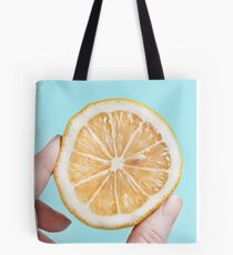 Juicy lemon on a blue background Tote Bag