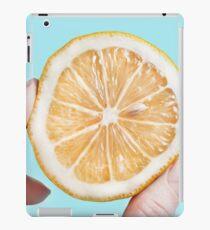 Juicy lemon on a blue background iPad Case/Skin