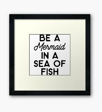 Be a mermaid in a sea of fish. Framed Print