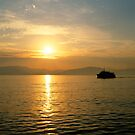 Sunrise over the greek islands by iOpeners