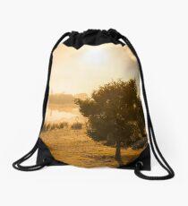 A Peaceful Glow Drawstring Bag