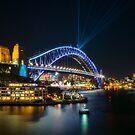 View of Sydney Harbour Bridge illuminated for Vivid by Danielasphotos