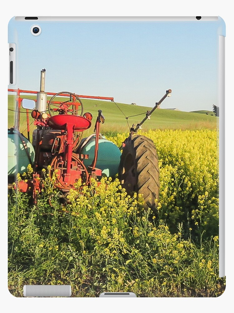Tractor and canola by Linda Sparks