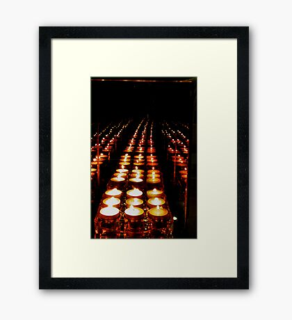 The candles come marching one by one  Framed Print