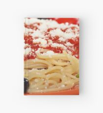 spaghetti with tomatoes and olives food background Hardcover Journal