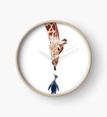 Giraffe kisses penguin small Clock