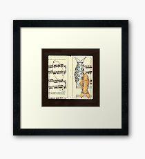 Fish above fingering Framed Print
