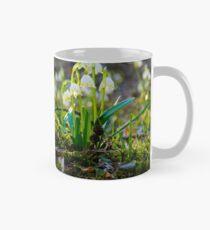 bunch of snowflake flowers on a mossy hump Mug