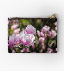 gorgeous magnolia flowers on a dark background Studio Pouch