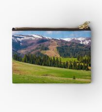 beautiful countryside with snow on mountain top Studio Pouch