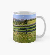 country road through grassy rural hillside Mug