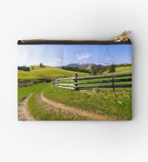 country road through grassy rural hillside Studio Pouch