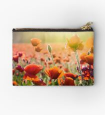 poppy flowers on the field in sunlight Studio Pouch