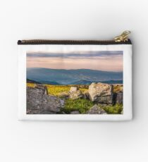 sunset light on hills with stones  Studio Pouch
