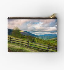 wooden fence across the hill Studio Pouch