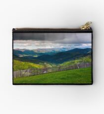 fence on the edge of the hillside Studio Pouch