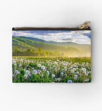 dandelion field on foggy sunrise Studio Pouch
