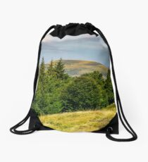 forested hills and meadows of Svydovets ridge Drawstring Bag