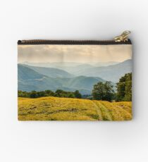 countryside road through grassy hill Studio Pouch