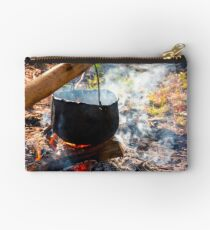 cauldron in steam and smoke on open fire Studio Pouch