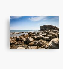 Cliff on spring time with the deep blue sea and sky with clouds Canvas Print