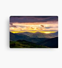 mountain rural area in springtime at cloudy sunset Canvas Print
