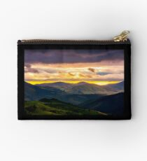 mountain rural area in springtime at cloudy sunset Studio Pouch