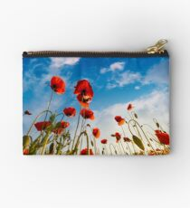 field of red papaver flower shot from below Studio Pouch