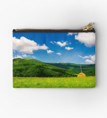haystack on a grassy pasture in mountains Studio Pouch