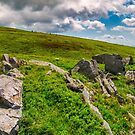 panorama of Runa mountain with rocks on hillside by mike-pellinni