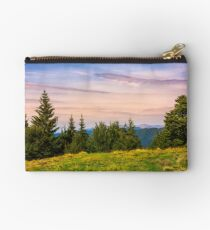 forested hills over the Brustury valley at dusk Studio Pouch