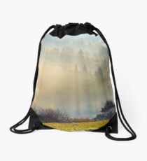 row of trees on the meadow in morning fog Drawstring Bag