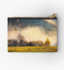 row of trees on the meadow in morning fog Studio Pouch